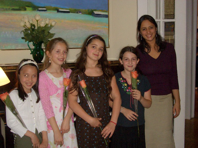 Reena with piano students after a recital